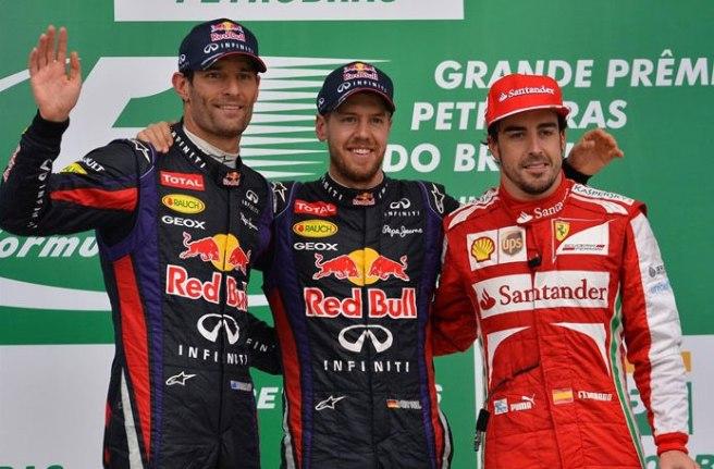 El podium del GP de Brasil, con los tres mejores pilotos del año