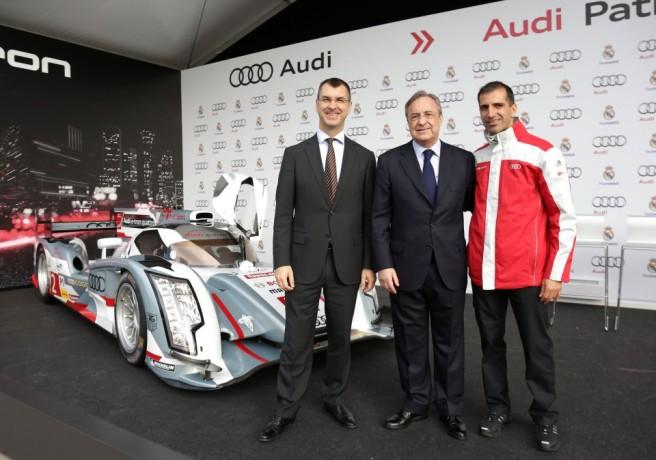 Marc Gené junto a Florentino Pérez y el director de Audi España