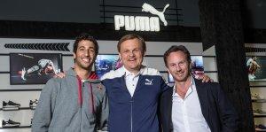 Björn Gulden, CEO de Puma, junto a Horner y Ricciardo