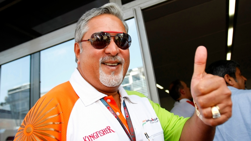 Force India team owner Mallya gives the thumb up at the end of the third practice session of the Italian F1 Grand Prix in Monza